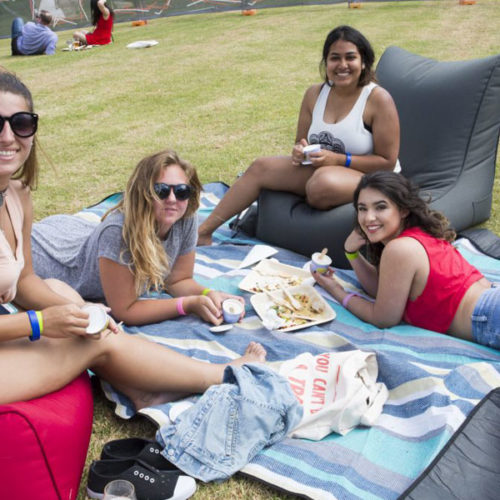 friends celebrate La Trobe University 50th celebration with bean bags
